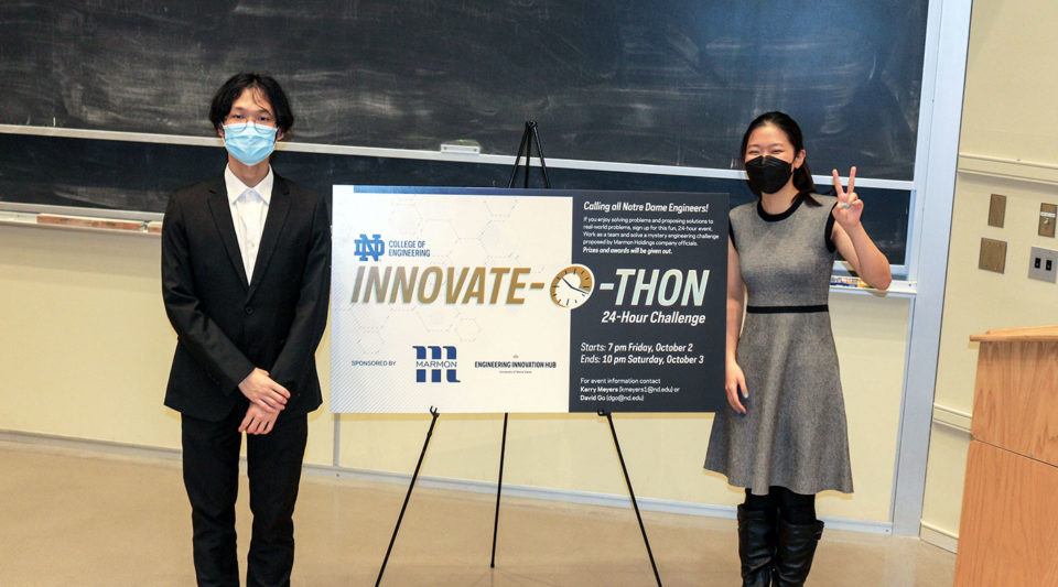 Innovate-o-thon participants standing in front of sign for competition