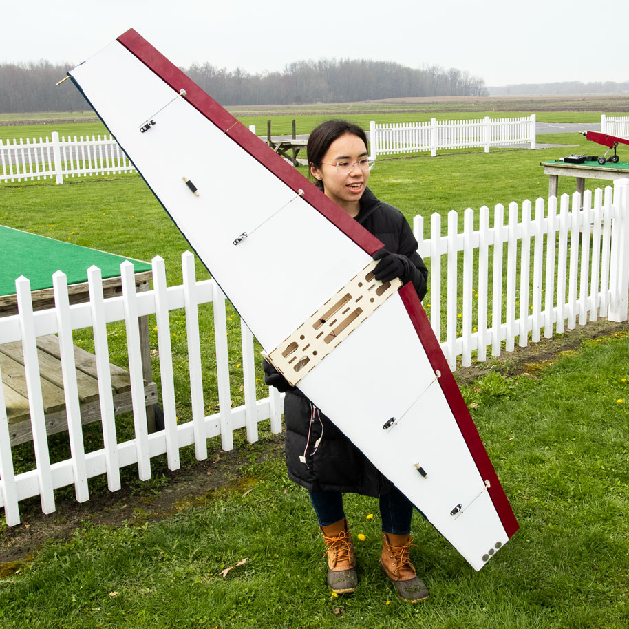 AME senior student holding RC plane before a test flight